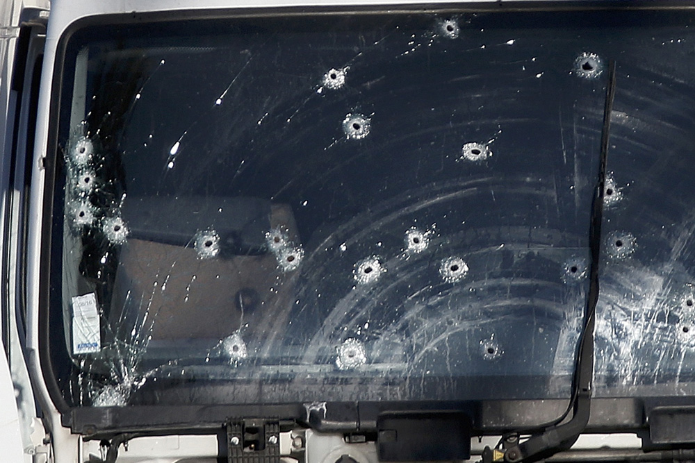 Bullet impacts are seen on the heavy truck the day after it ran into a crowd at high speed killing scores celebrating the Bastille Day July 14 national holiday on the Promenade des Anglais in Nice, France, July 15, 2016. REUTERS/Eric Gaillard