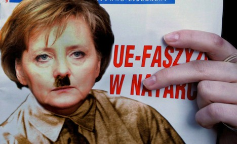 The cover of March number of newspaper 'Najwyzszy Czas!' shows a picture of German chancelor Angela Merkel in a brown uniform with a moustache looking like Adolf Hitler, 2 March 2007. EPA/STF +++(c) dpa - Bildfunk+++
